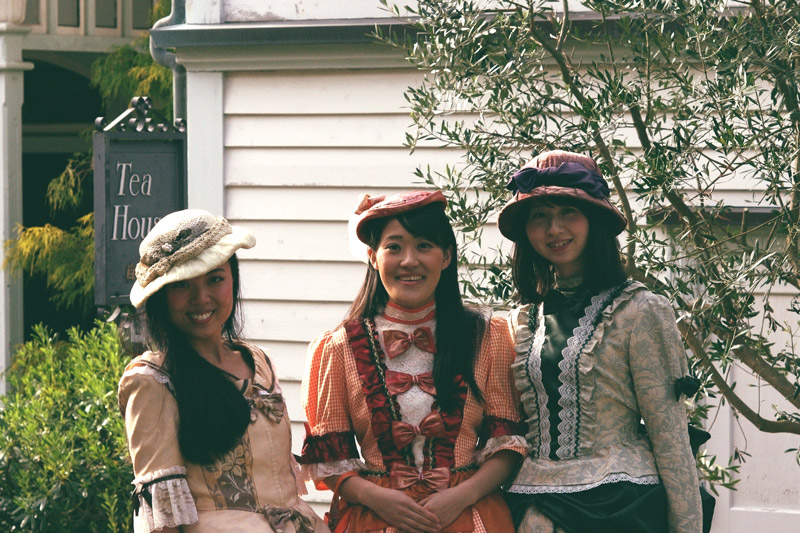 Three women standing in front of Tea House in Dutch costumes