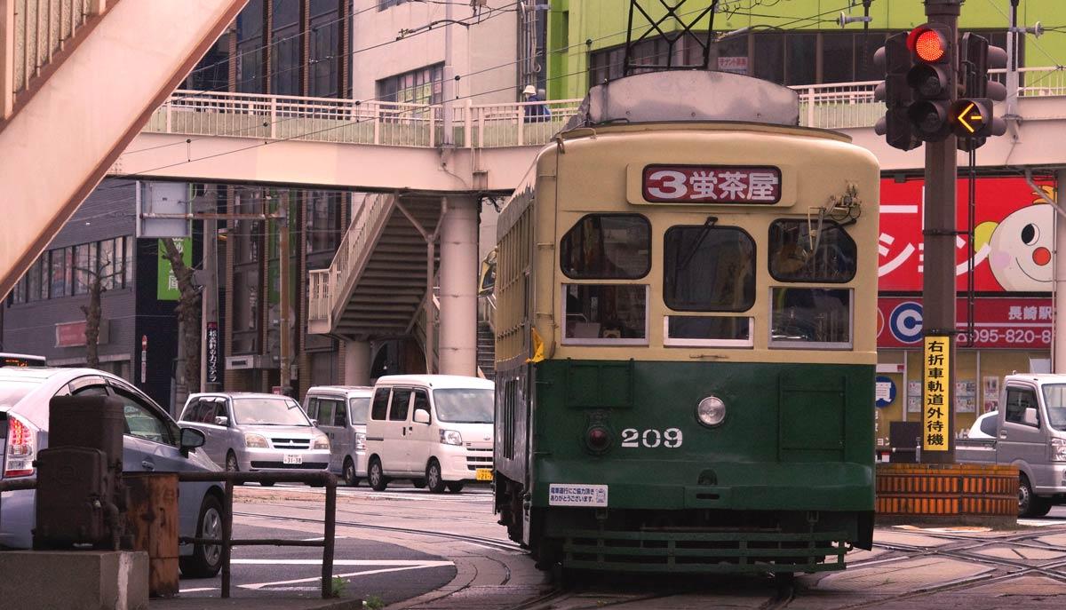 Tram in busy Nagasaki street