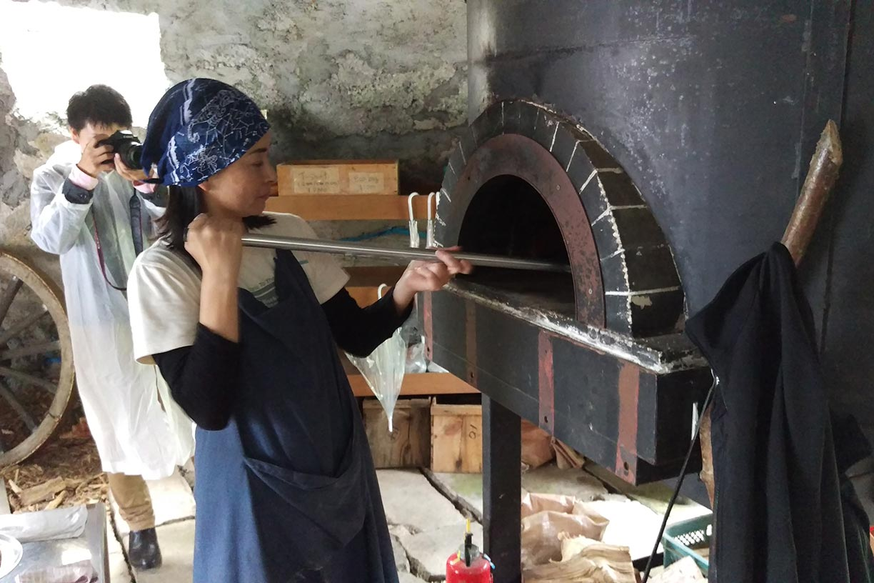 Pizza going in to the wood fire oven
