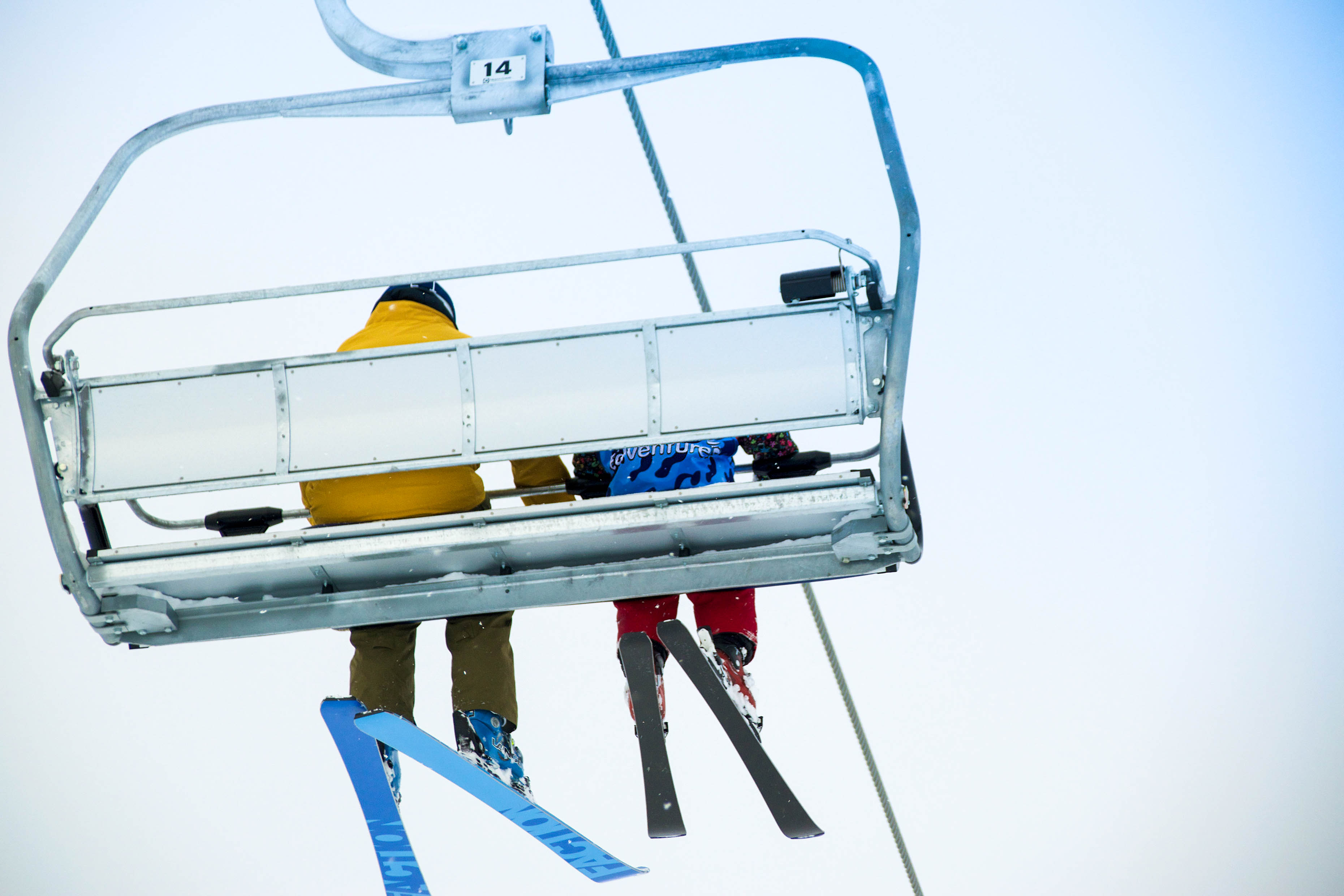 An EdVenture camper on the Niseko lifts during their afternoon ski lesson
