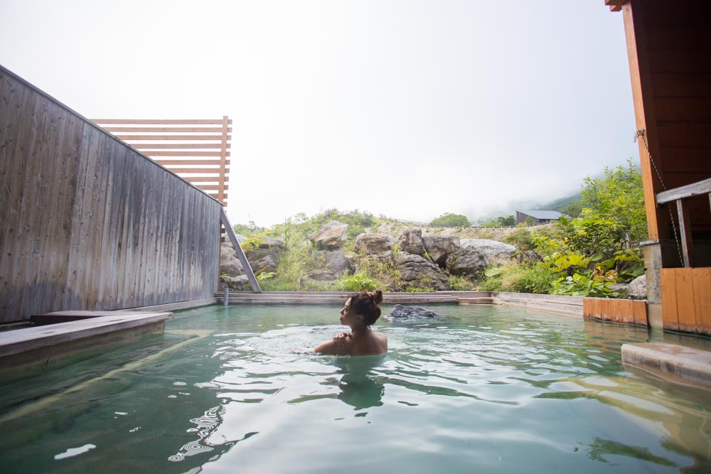 Woman bathing in an onsen in Niseko Japan