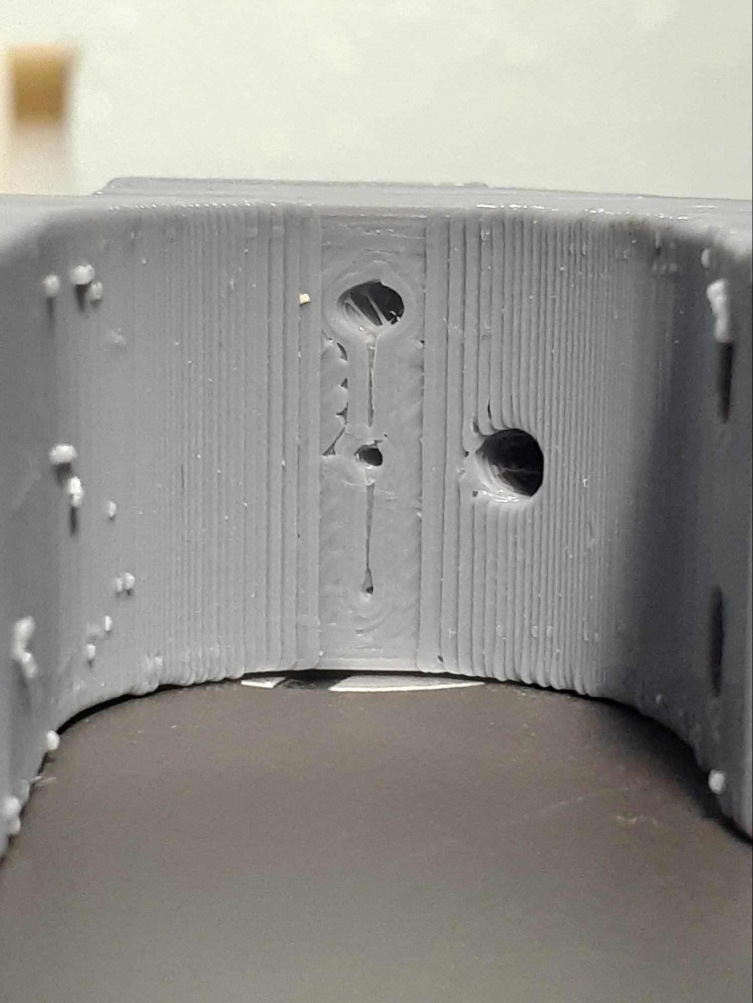 Comparing the different holes on each material from the front along the part's hidden curved surface