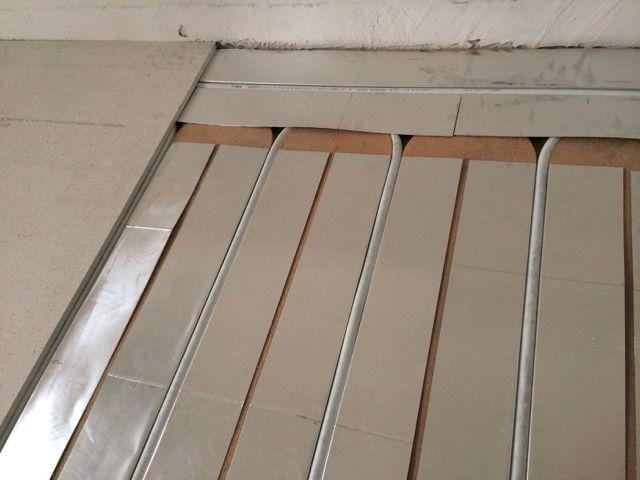 Chauffage remarquable du plancherr chauffant à NeuChâtel - Peseux par tôles aluminium recouvrant toute la surface