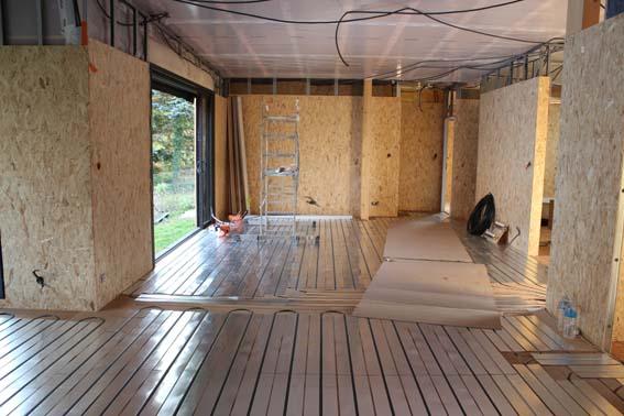 Plancher chauffant sec Caleosol Tradi ECO+ dans la construction maison ossature bois