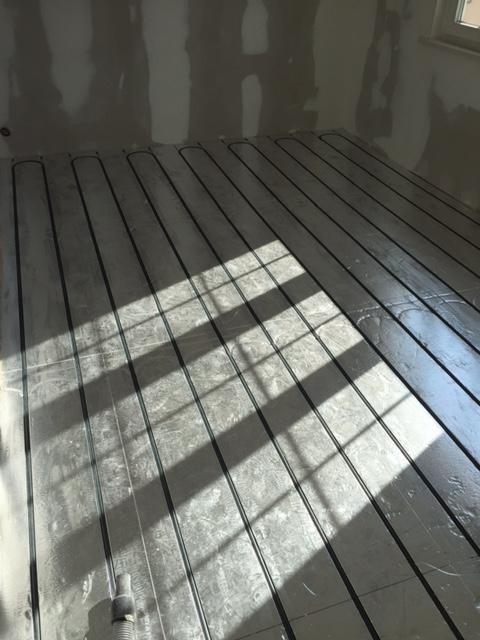 installation plancher chauffant eau rénovation
