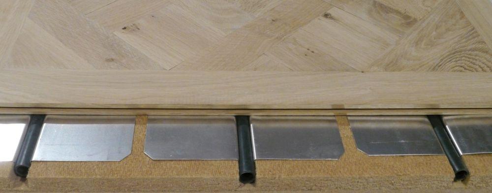 Pose de dalle de versailles sur plancher chauffant