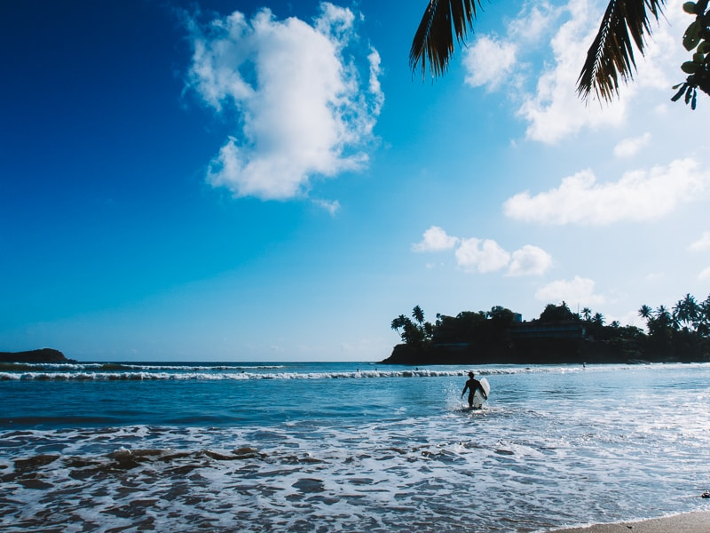 surfing at unawatuna beach