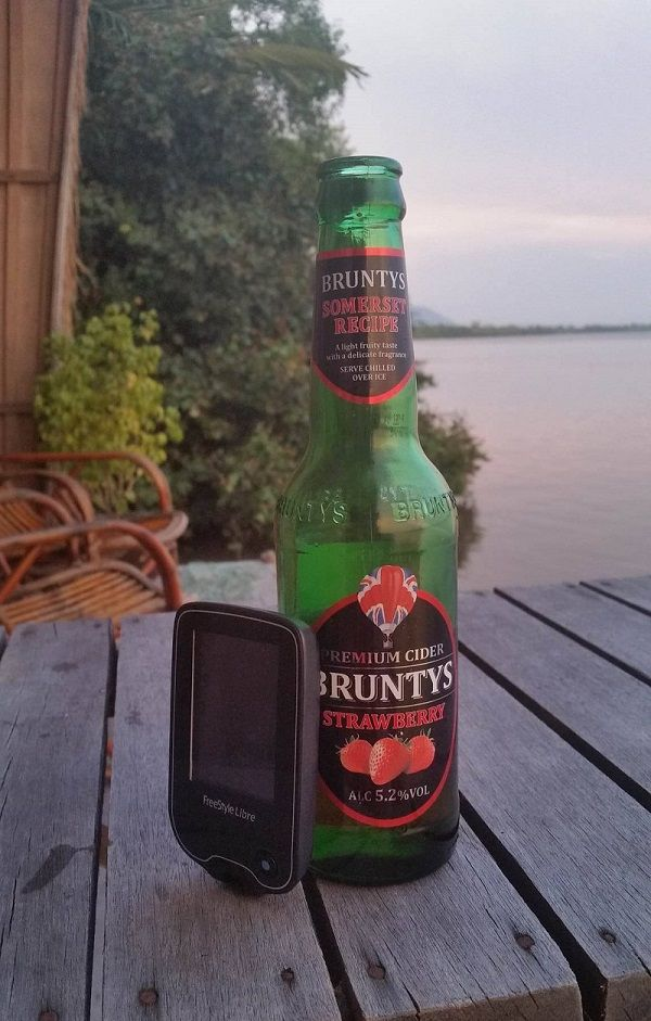 Drinking cider by Kampot River