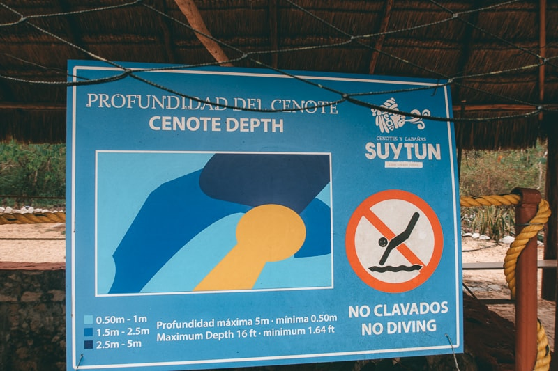 swimming guide at cenote suytun