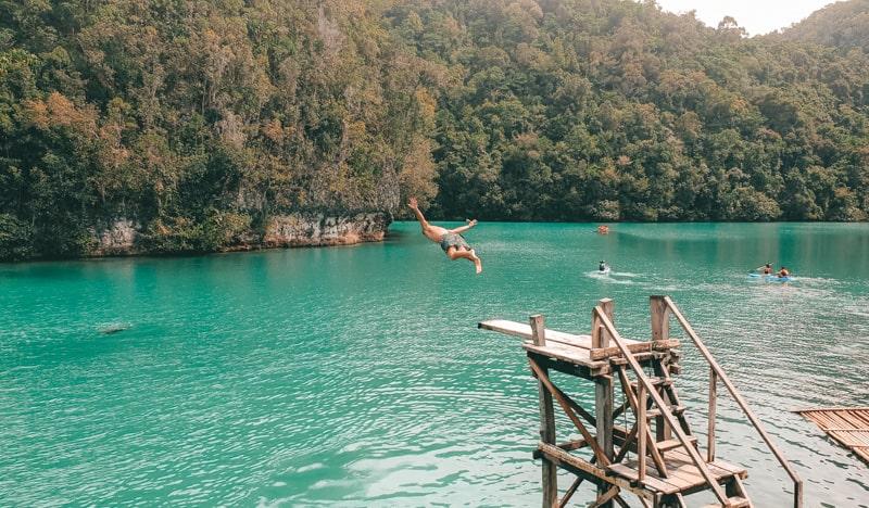 jumping into sugba lagoon
