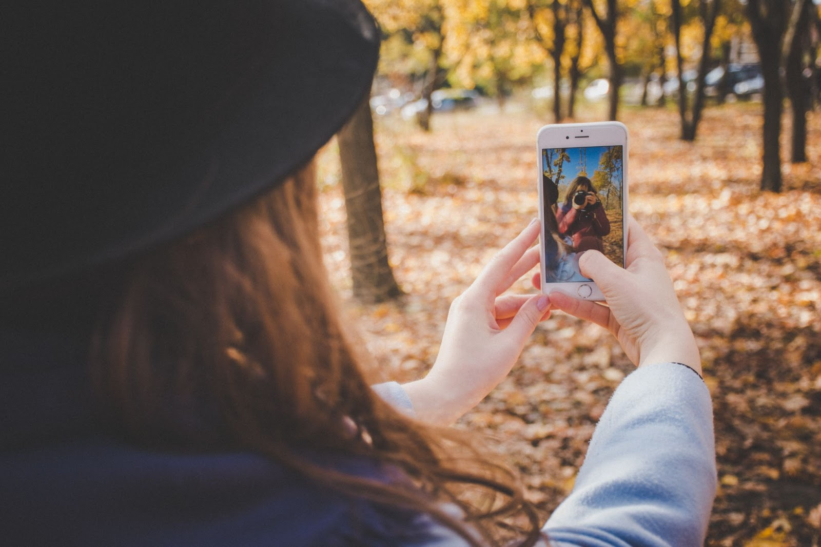 A girl taking a selfie in a park