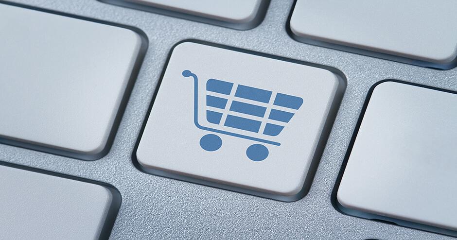 Imagem de um botão de teclado de computador com um carrinho de supermercado desenhado.