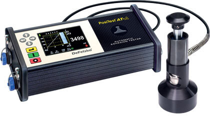 Photo of the PosiTest AT-A Automatic Adhesion Tester with the 50 mm concrete surfaces and overlay standoff