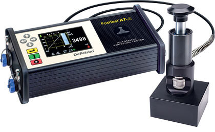 Photo of the PosiTest AT-A Automatic Adhesion Tester with the 50x50 mm tile adhesion strength standoff