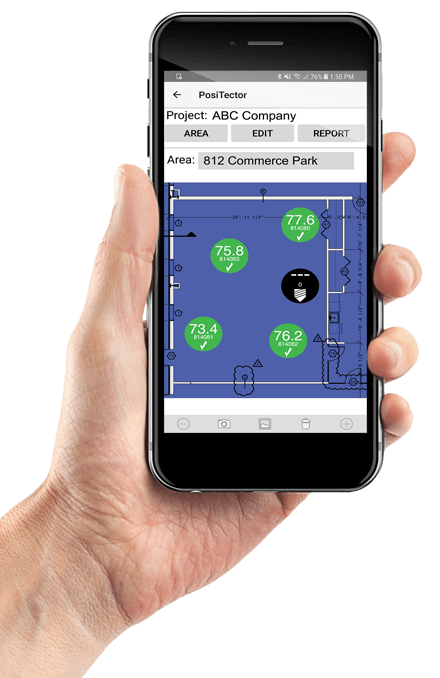An image of a hand holding a phone using the PosiTector App with the PosiTector CMM IS planning map