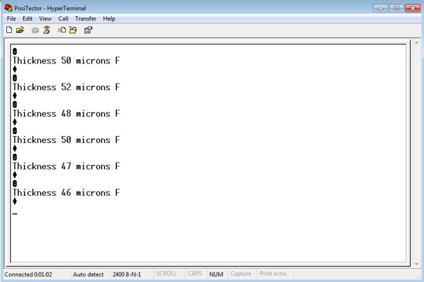 Image of HyperTerminal window showing readings from a PosiTector gage body setup with USB Serial Streaming Mode