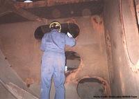 Inspector taking measurements inside ballast