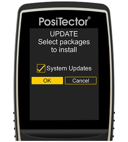 """Image of a PosiTector gage body, the screen says """"UPDATE, Select packages to install"""", """"System updates"""" is checked and the """"OK"""" button is selected"""