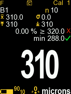 Screenshot from PosiTector gage body of measurement screen with PosiTector 6000 probe attached, in this example the 10% rule passes and has a green check while the 90% rule fails with a red X