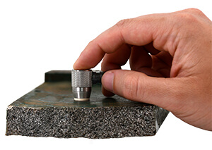 An image of the PosiTector UTG CLF probe measuring the thickness of concrete