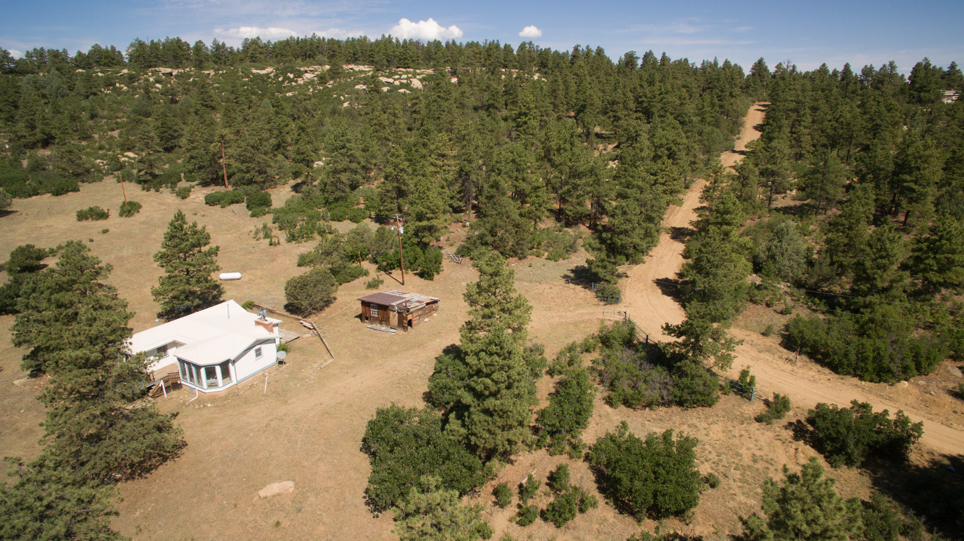 Home & cabins on a neighboring property at the base of the ridge