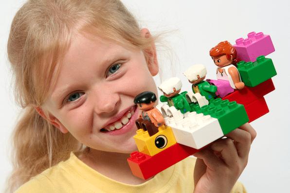 Girl Holding Legos
