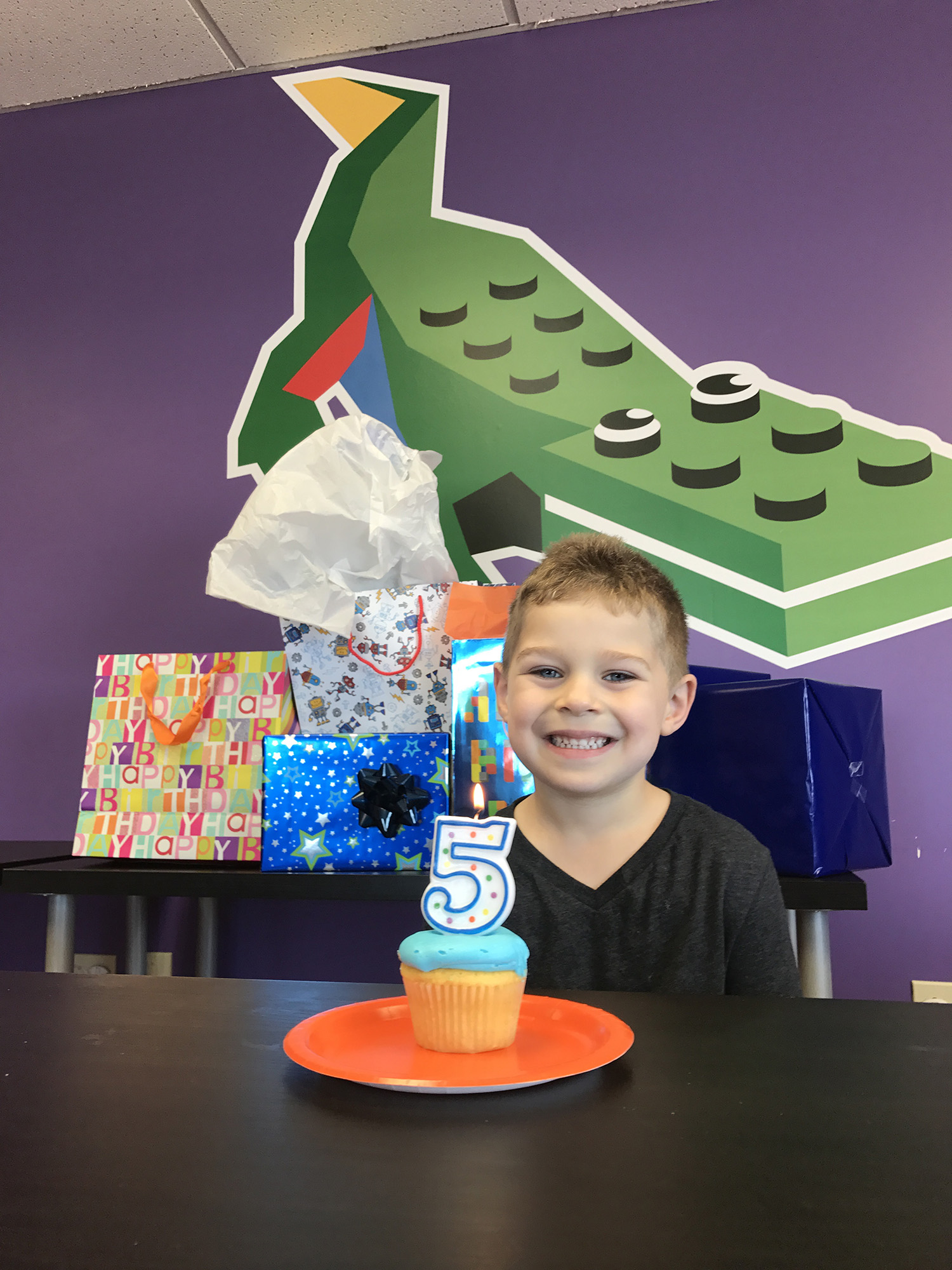 Boy smiling while celebrating his birthday