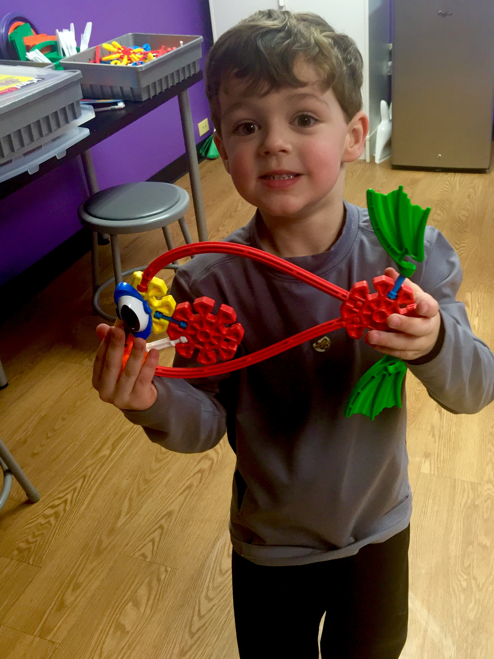 Boy playing with Knex fish