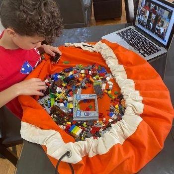 Boy taking online LEGO class