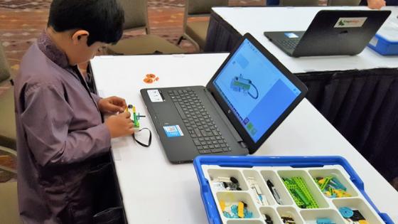 Child in Robotics Class