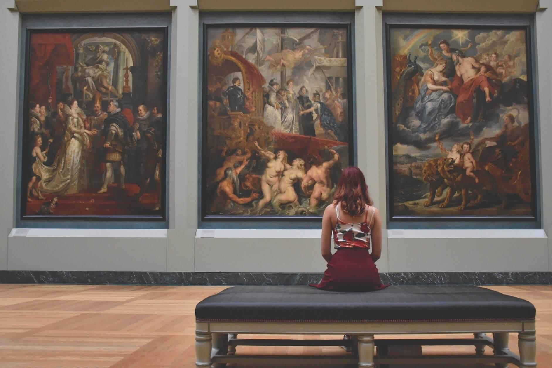 woman sitting inside art museum