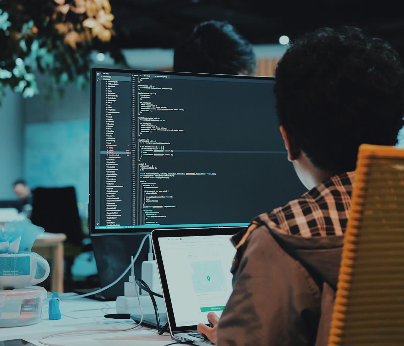 software developer coding on computer