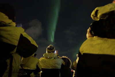 Passengers enjyoing the northern lights