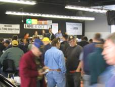 Photo of a group of people at a car auction
