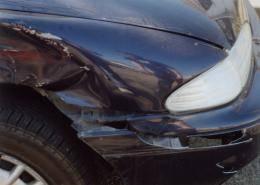 Photo of a car fender that has taken damage