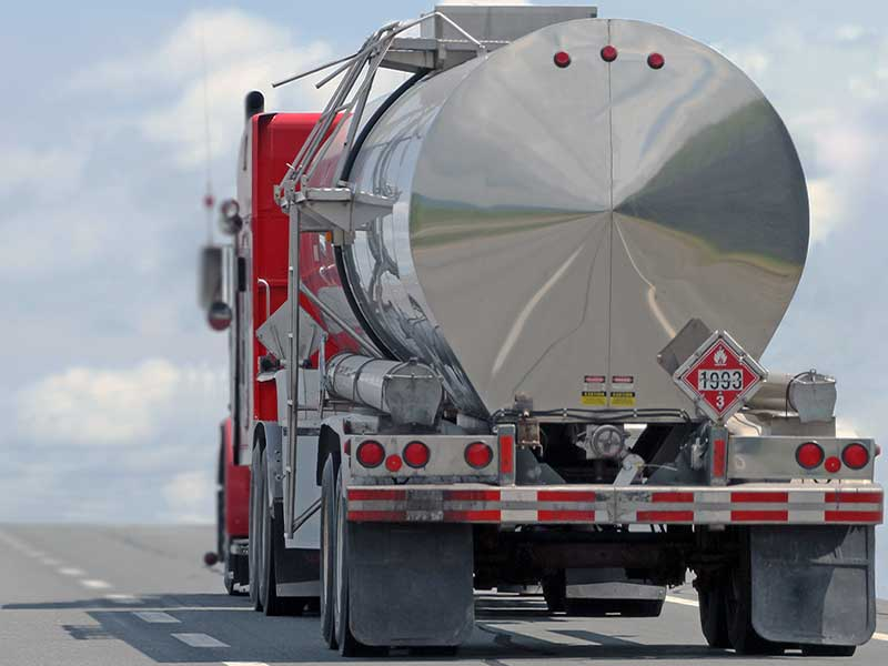 A cargo tank truck on the highway transporting flammable material
