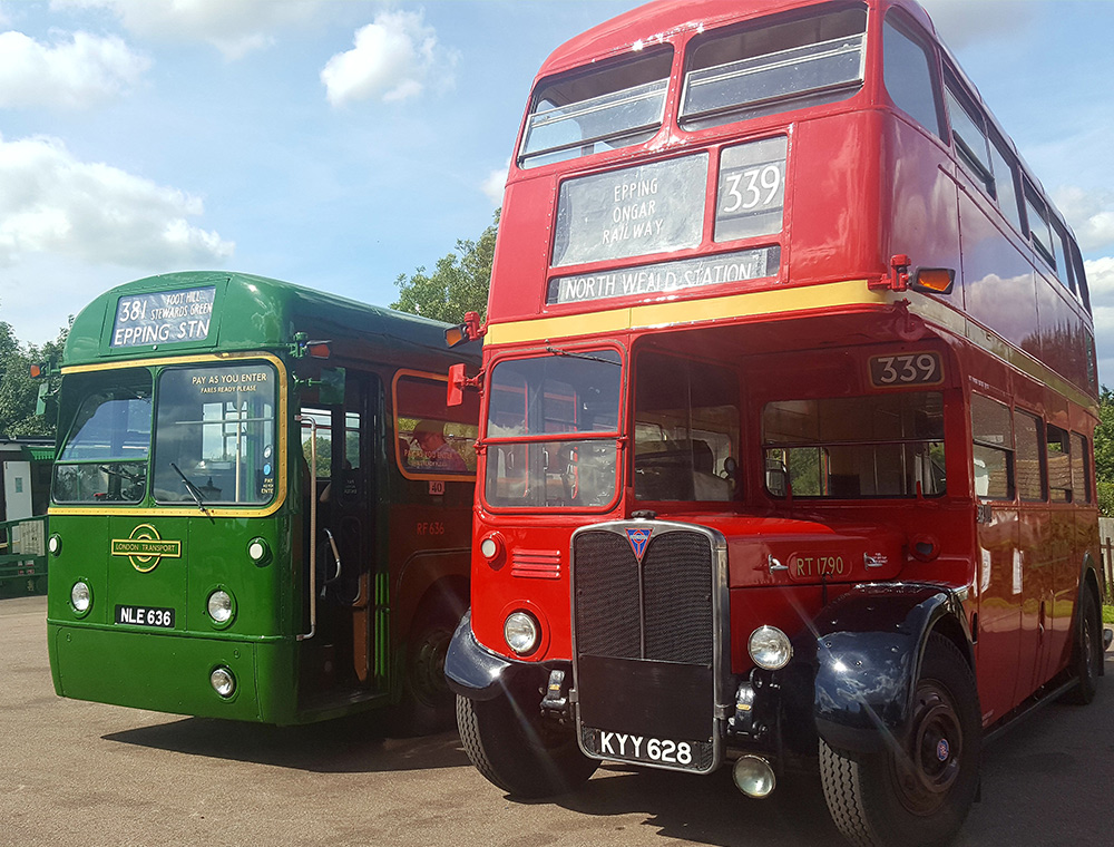 Vintage buses. One green one red.