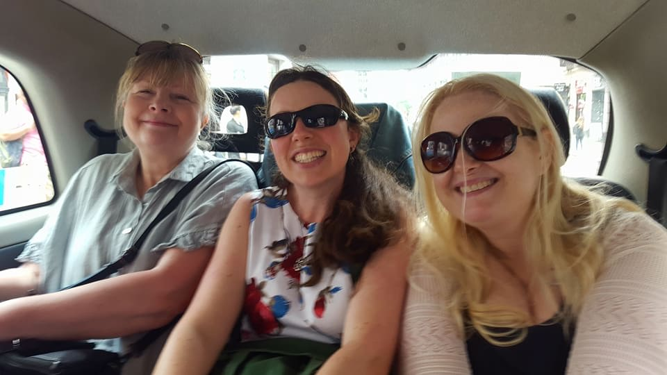 3 women inside taxi on london tour