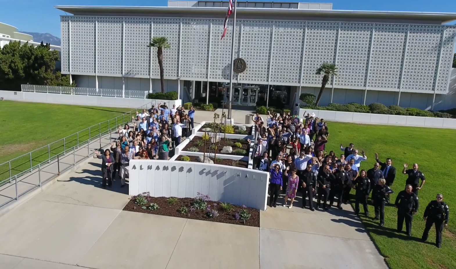 Picture of city employees standing in front of City Hall