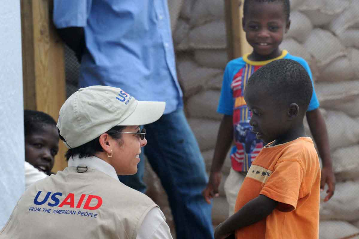 Alexandra Riboul with USAID talks with children at Tabarre Issa Emergency Relocation Camp in Haiti on June 7, 2010.