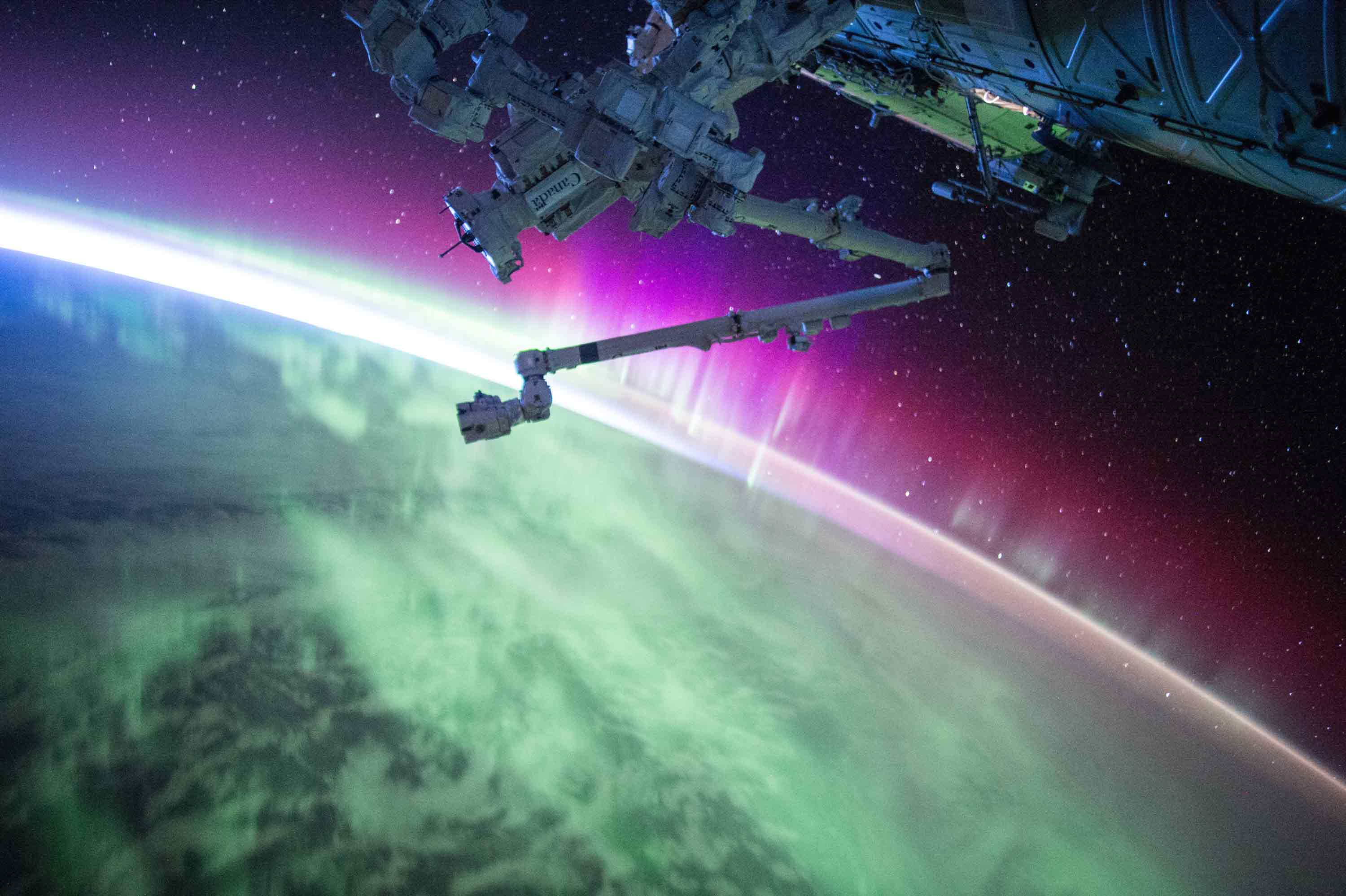 Photo of the International Space Station and the aurora by NASA.