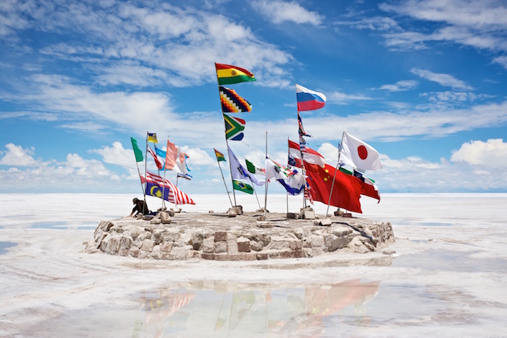Country flags fly at the Salar de Uyuni salt flats in Bolivia. Photo by Nico Kaiser via Flickr, licensed under (CC BY 2.0).