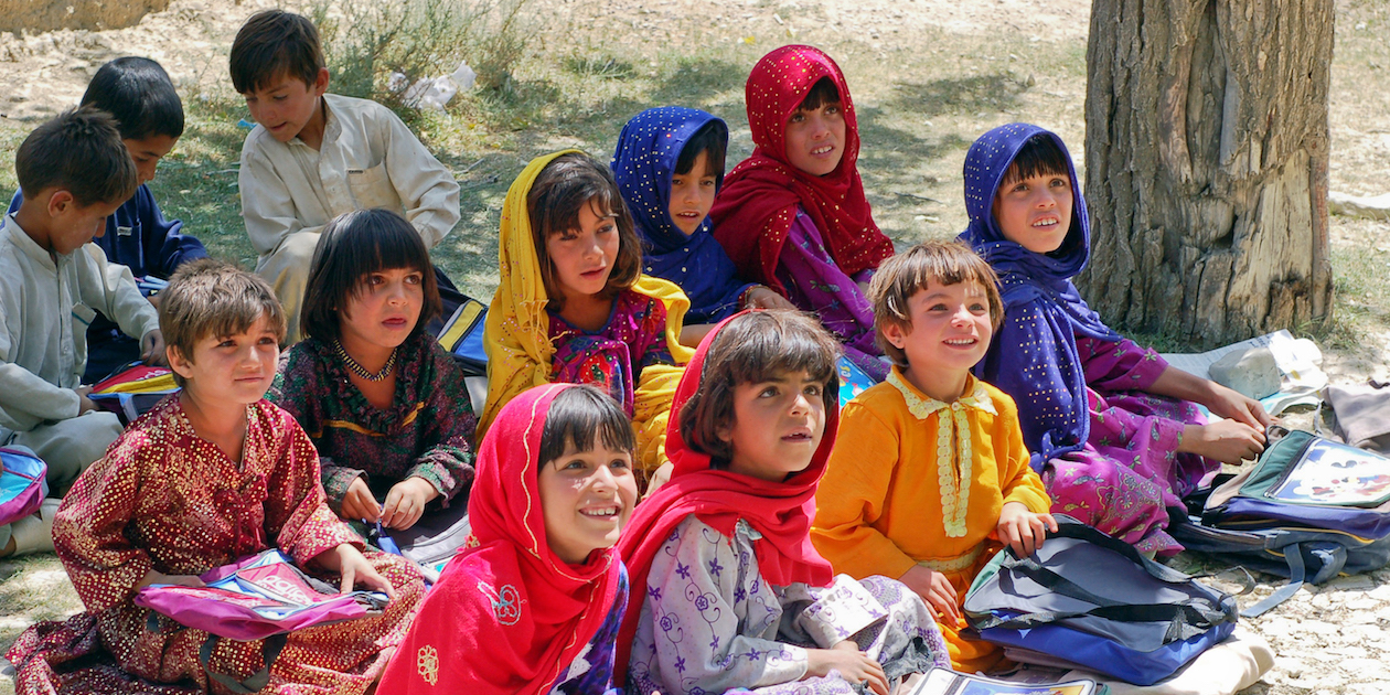 Girls sit at school in Bamozai, near Gardez, Paktya Province, Afghanistan. Photo by Capt. John Severns, U.S. Air Force via Wikimedia (public domain).