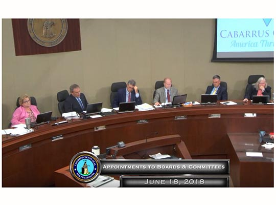 Commissioners at June 18 meeting