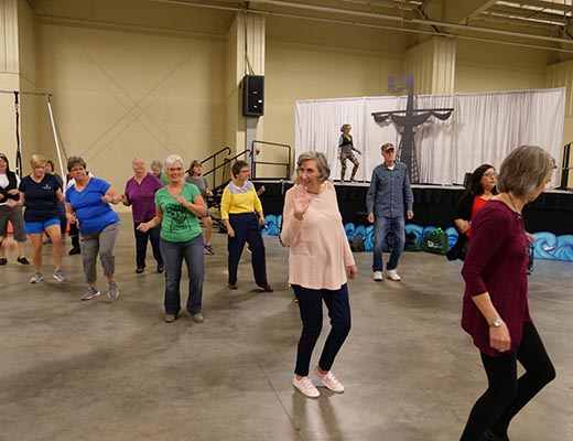 Cabarrus residents line dancing at the expo