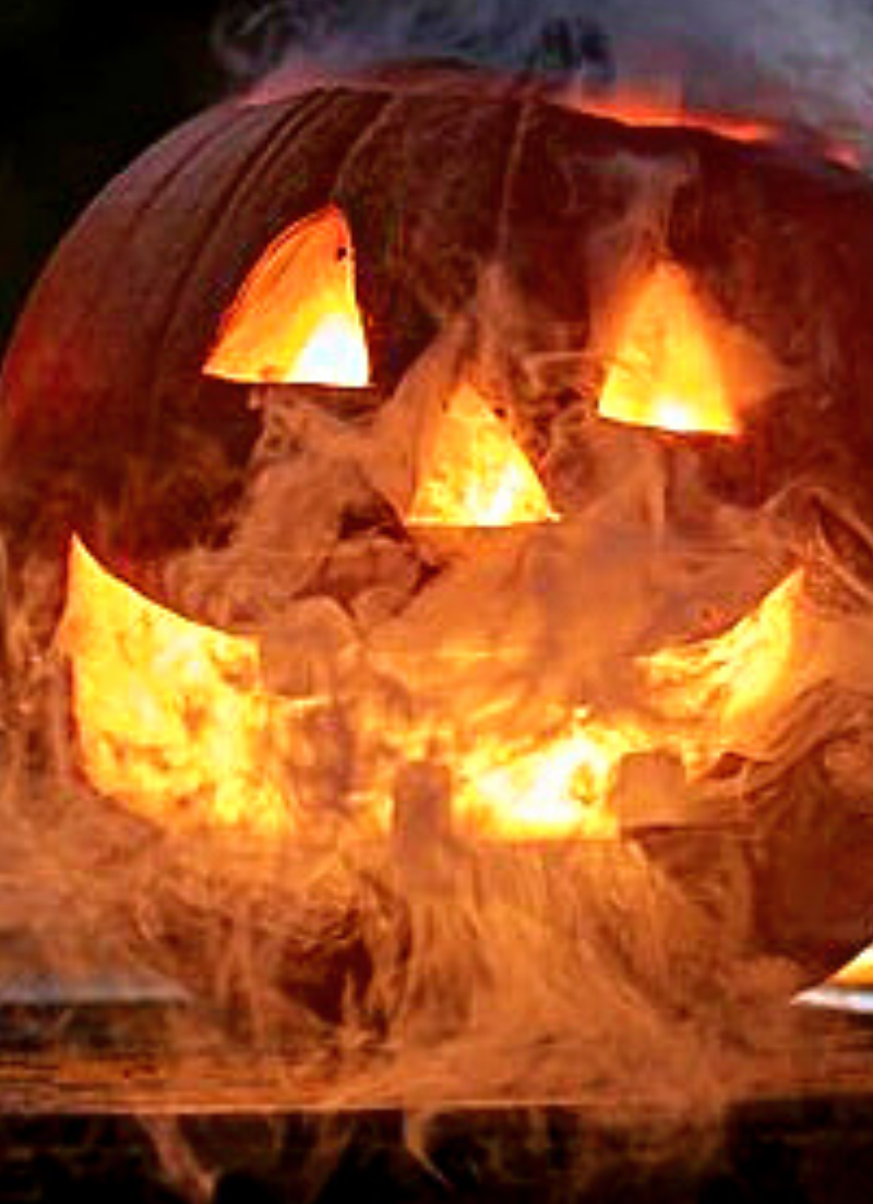 Jack-o-lantern pumpkin steaming with dry ice