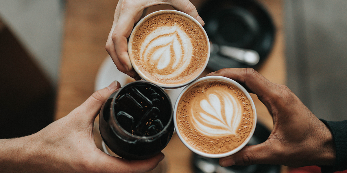 an image of people holding different kinds of coffee