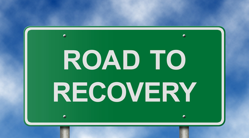 sign that says road to recovery