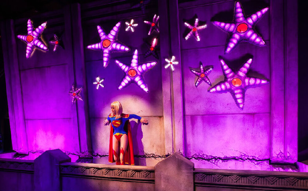 Super Woman animatronic holds up a falling wall in JUSTICE LEAGUE: Alien Invasion