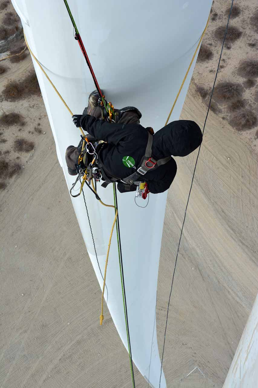 Rope Partner Technician looking down blade leading edge